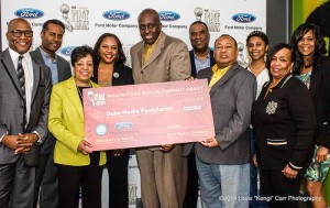 "Angela H. Polk Program Manager, Community Development for Ford Motor Company Fund presenting $10,000 check to Mr. Bill Duke of Duke Media Foundation and his board members along with representatives of the NAACP Hollywood Bureau. | Photo credit: Louis ""Kengi"" Carr Photography"